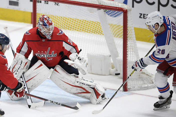 New York Rangers left wing Chris Kreider (20) scores a goal against Washington Capitals goaltender Ilya Samsonov (30) during the third period of an NHL hockey game, Sunday, March 28, 2021, in Washington. (AP Photo/Nick Wass)
