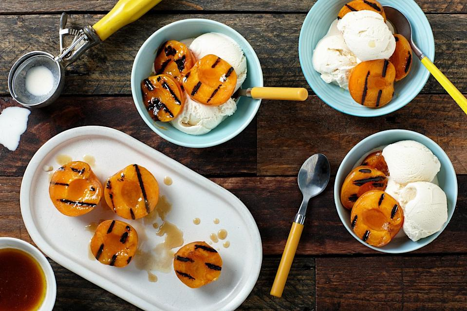 """Step aside, pancakes; butter and maple syrup have elsewhere to go. The combo is worthy of the ripest grilled summer fruits. Can't find apricots? Try this grilled dessert recipe with <a href=""""https://www.epicurious.com/recipes-menus/fresh-peach-desserts-gallery?mbid=synd_yahoo_rss"""" rel=""""nofollow noopener"""" target=""""_blank"""" data-ylk=""""slk:peaches"""" class=""""link rapid-noclick-resp"""">peaches</a> or <a href=""""https://www.epicurious.com/ingredients/how-to-eat-all-the-plums-gallery?mbid=synd_yahoo_rss"""" rel=""""nofollow noopener"""" target=""""_blank"""" data-ylk=""""slk:plums"""" class=""""link rapid-noclick-resp"""">plums</a> for a fantastic ice cream topping. <a href=""""https://www.epicurious.com/recipes/food/views/grilled-maple-butter-apricots-with-vanilla-ice-cream-56389626?mbid=synd_yahoo_rss"""" rel=""""nofollow noopener"""" target=""""_blank"""" data-ylk=""""slk:See recipe."""" class=""""link rapid-noclick-resp"""">See recipe.</a>"""