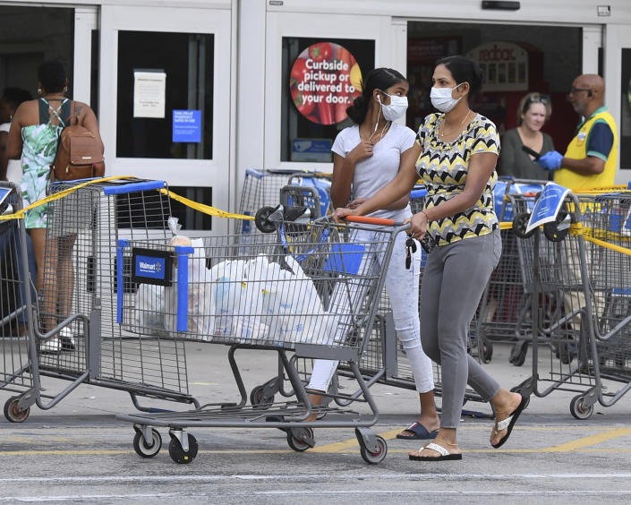 COCONUT CREEK, FL - APRIL 04: Shoppers stock up as Walmart on Saturday began limiting the number of customers who can be in it's stores at once due to the Coronavirus (COVID-19) pandemic on April 4, 2020 in Coconut Creek, Florida Credit: mpi04/MediaPunch /IPX