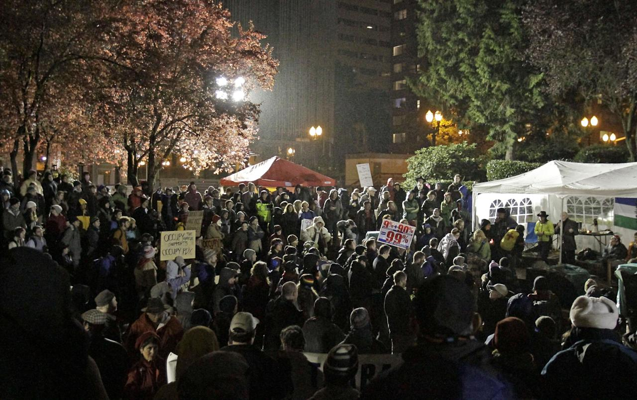 Hundreds of protesters and supporters gather hours before a mandate from the city to vacate the Occupy Portland Camp in Portland, Ore., Saturday, Nov. 12, 2011.(AP Photo/Don Ryan)