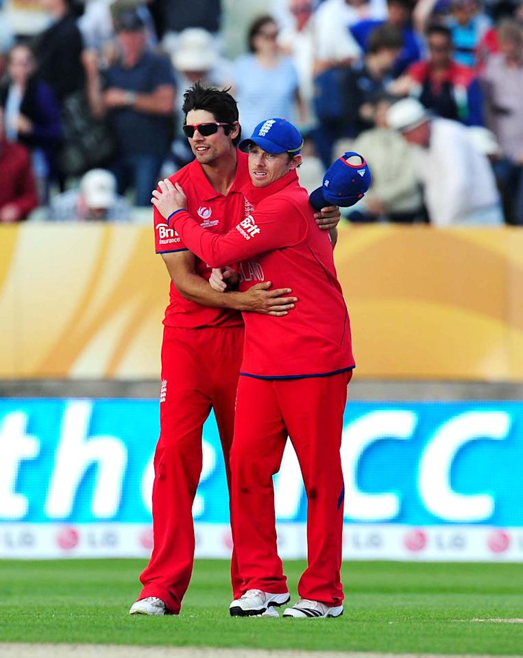 England's Alastair Cook and Ian Bell during the ICC Champions Trophy match at Edgbaston, Birmingham.