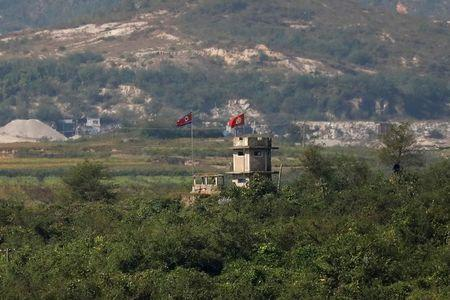 FILE PHOTO - A North Korean flag flutters at a guard post near the propaganda village of Gijungdong in North Korea, in this picture taken near the truce village of Panmunjom, South Korea, September 28, 2017.  REUTERS/Kim Hong-Ji