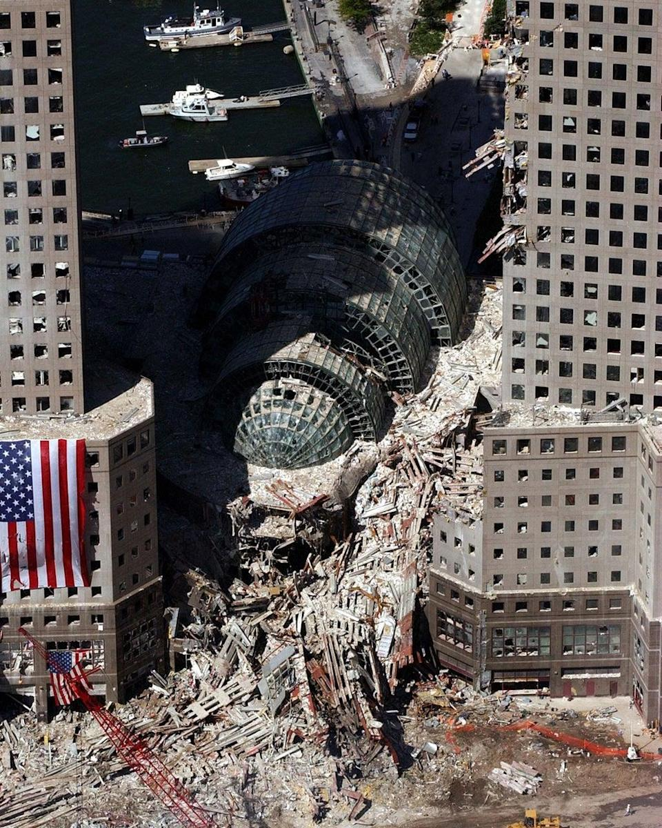 The Winter Garden surrounded by debris. Buildings nearby were heavily damaged by the falling twin towers (AP)