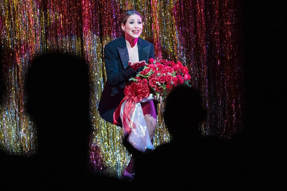 <p>Picture right, Bianca Marroquín, who plays Velma Kelly in the show, accepting a bouquet of flowers on opening night. </p>