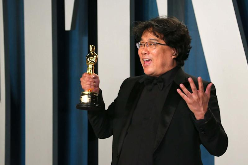 Bong Joon-Ho with one of his Oscars (AFP via Getty Images)