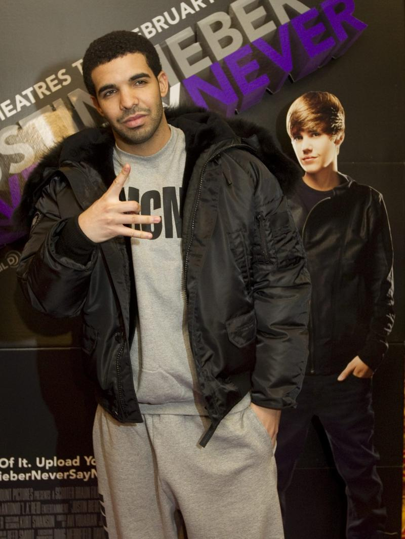 """FILE - In a Feb. 1, 2011 file photo Rapper Drake arrives at the screening of the film """"Justin Bieber: Never Say Never"""" in Toronto. Drake received five nominations for the MTV Video Music Awards in 2012. (AP Photo/The Canadian Press, Darren Calabrese, file)"""