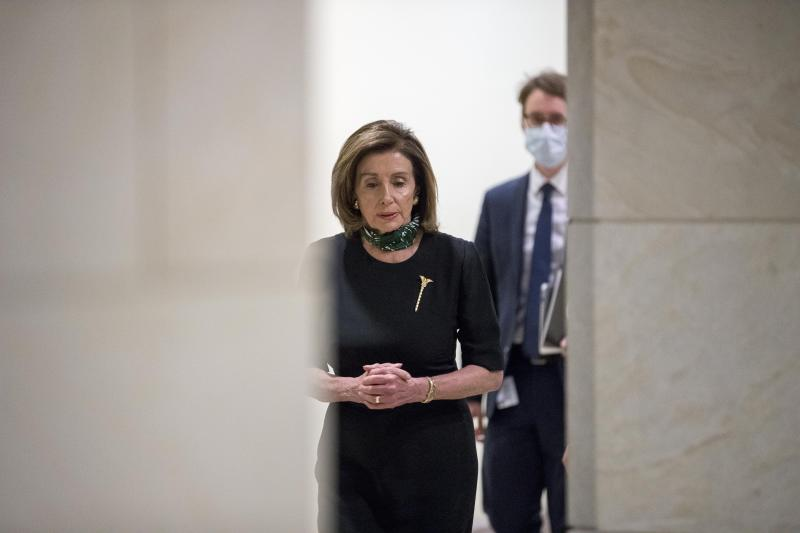 House Speaker Nancy Pelosi of Calif., arrives for a news conference on Capitol Hill, Thursday, May 14, 2020, in Washington. (AP Photo/Andrew Harnik)