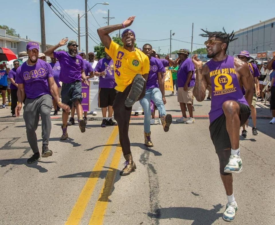 Members of the Omega Psi Phi fraternity performed a step routine in front of the judges stand at the JuneteenthKC 2021 Cultural Parade Saturday, June 12, 2021 in the Historic Jazz District near 18th and Vine.