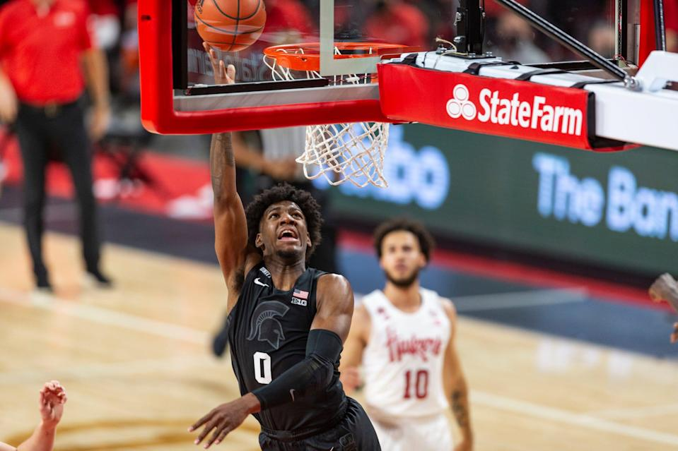 Michigan State forward Aaron Henry (0) makes a layup against Nebraska in the second half during an NCAA college basketball game on Saturday, Jan. 2, 2021, in Lincoln, Neb.