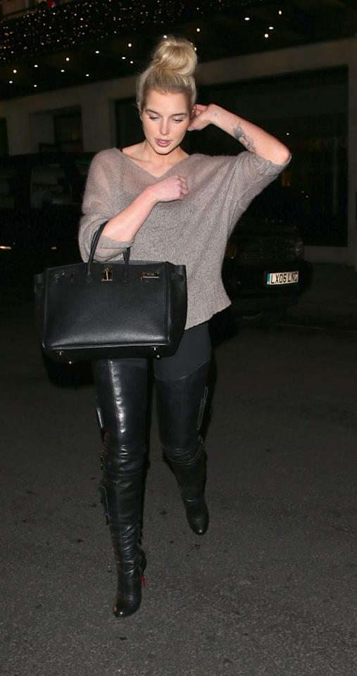 Celebrities in thigh-high boots: Helen Flanagan took this trend to new extremes in these sexy boots which covered pretty much her entire legs. Copyright [WENN]