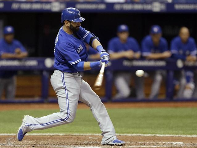 Toronto Blue Jays' Jose Bautista connects for a seventh-inning home run off Tampa Bay Rays relief pitcher Josh Lueke during a baseball game Wednesday, April 2, 2014, in St. Petersburg, Fla. Bautista also hit a home run in the fourth inning. (AP Photo/Chris O'Meara)