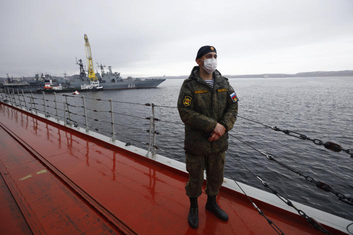 A Russian sailor stands guard on board of the Northern Fleet's flagship, the Pyotr Veilikiy (Peter the Great) missile cruiser, at its Arctic base of Severomorsk, Russia, Thursday, May 13, 2021. Adm. Alexander Moiseyev, the commander of Russia's Northern Fleet griped Thursday about increased NATO's military activities near the country's borders, describing them as a threat to regional security. (AP Photo/Alexander Zemlianichenko)
