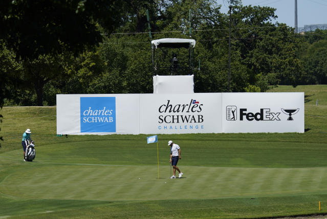 Dustin Johnson putts on the 13th green during practice for the Charles Schwab Challenge golf tournament at the Colonial Country Club in Fort Worth, Texas, Wednesday, June 10, 2020. (AP Photo/David J. Phillip)