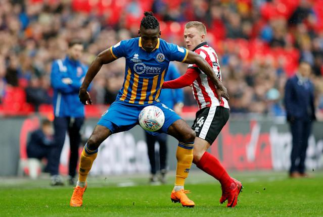 "Soccer Football - Checkatrade Trophy Final - Lincoln City vs Shrewsbury Town - Wembley Stadium, London, Britain - April 8, 2018 Shrewsbury Town's Omar Beckles in action with Lincoln City's Danny Rowe Action Images/Matthew Childs EDITORIAL USE ONLY. No use with unauthorized audio, video, data, fixture lists, club/league logos or ""live"" services. Online in-match use limited to 75 images, no video emulation. No use in betting, games or single club/league/player publications. Please contact your account representative for further details."