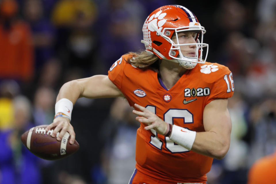 FILE - Clemson quarterback Trevor Lawrence passes against LSU during the second half of a NCAA College Football Playoff national championship game in New Orleans, in this Monday, Jan. 13, 2020, file photo. Ohio State quarterback Justin Fields was among 98 juniors granted eligibility by the NFL into the draft, while national championship-winning QBs Mac Jones from Alabama and Trevor Lawrence from Clemson were among another 30 players eligible after completing their degrees and deciding not to play more in college. (AP Photo/Gerald Herbert, File)