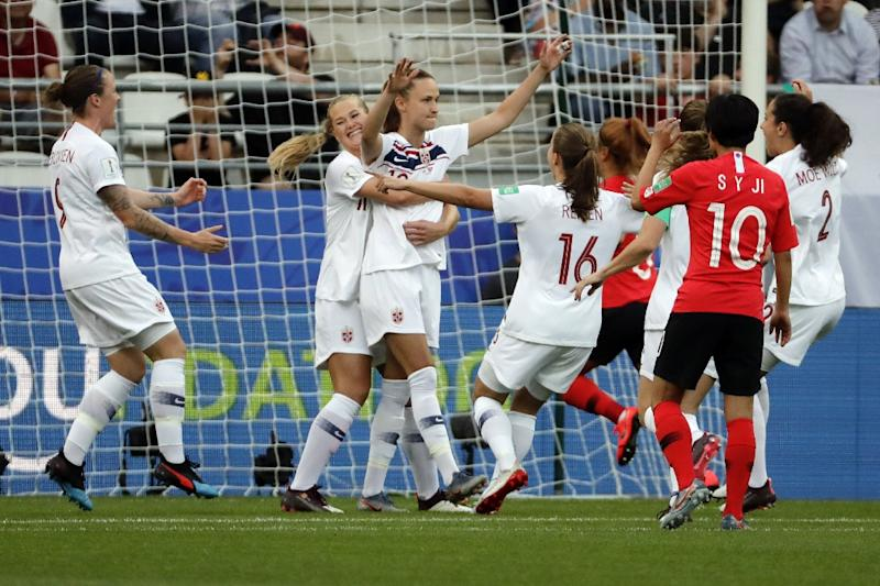 Norway's Caroline Graham Hansen (centre) is congratulated after opening the scoring from the spot against South Korea on Tuesday (AFP Photo/THOMAS SAMSON)