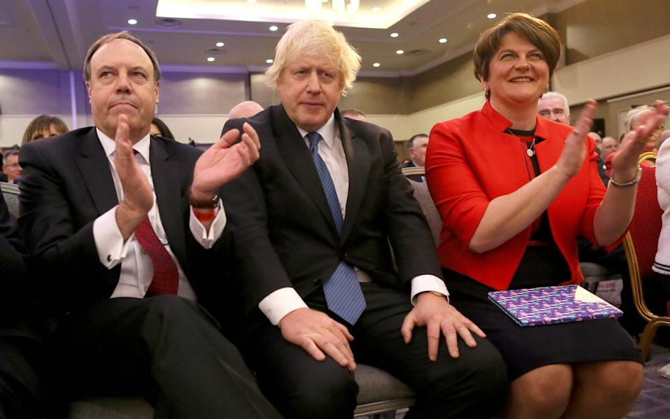 Lord Dodds with Boris Johnson and Arlene Foster at the DUP party conference in 2018 - GETTY IMAGES