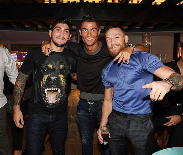 """Jiu-jitsu star Dillon Danis (L), along with Real Madrid's <a class=""""link rapid-noclick-resp"""" href=""""/soccer/players/cristiano-ronaldo"""" data-ylk=""""slk:Cristiano Ronaldo"""">Cristiano Ronaldo</a> (C) and close friend Conor McGregor of the UFC (R), signed a promotional deal with Bellator MMA on Monday. (Getty Images)"""