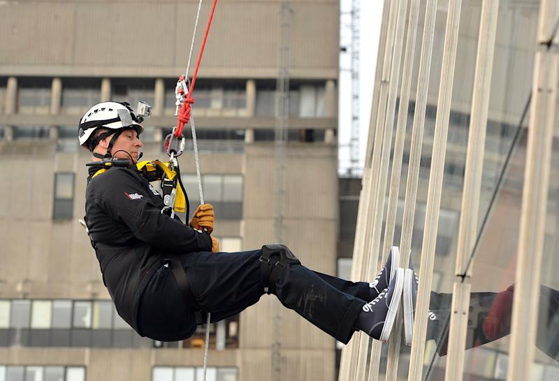 Britain's Prince Andrew abseils down The Shard, the tallest building in Europe, for charity in central London Monday, Sept. 3, 2012. The 52-year-old royal descended the Shard skyscraper in London, beginning his daredevil stunt from the 87th floor - just below the top of the 1,016ft tower - and finishing half an hour later on level 20. Prince Andrew trained with the Royal Marines in Arbroath, Scotland over the summer to prepare for the challenge. (AP Photo/Max Nash/PA Wire)  UNITED KINGDOM OUT
