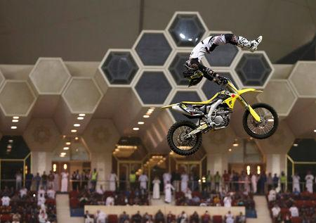 FILE PHOTO: Motorcyclist performs during Monster Jam show which was organized by General Entertainment Authority, in Riyadh