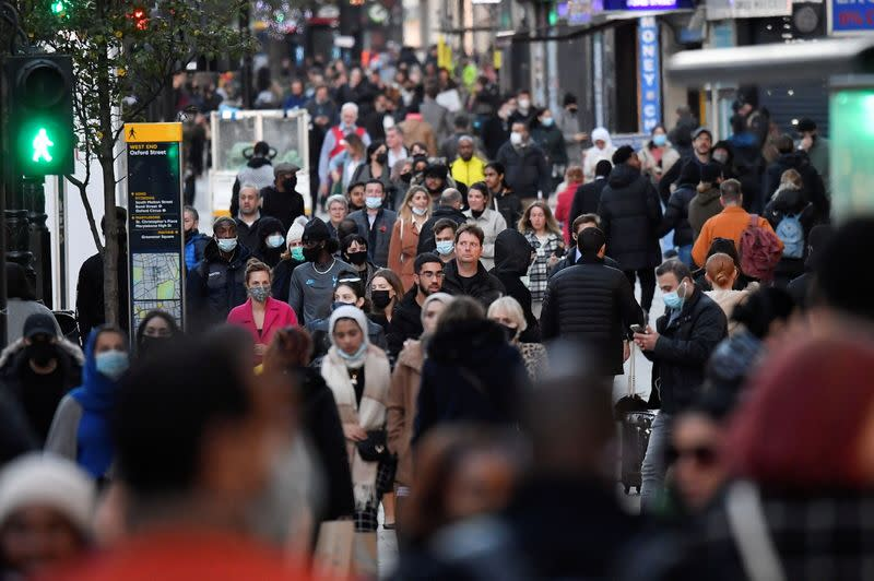 Shoppers walk after new nationwide restrictions were announced