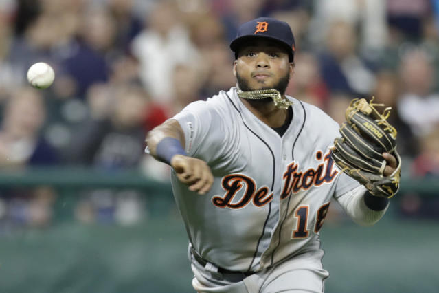 Detroit Tigers' Dawel Lugo throws out Cleveland Indians' Greg Allen at first base during the third inning of a baseball game Tuesday, Sept. 17, 2019, in Cleveland. (AP Photo/Tony Dejak)