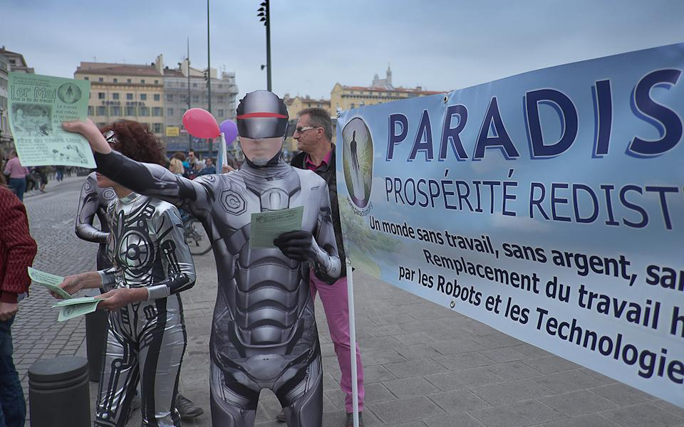 Raelians in costumes handing out pamphlets. Source: Getty Images
