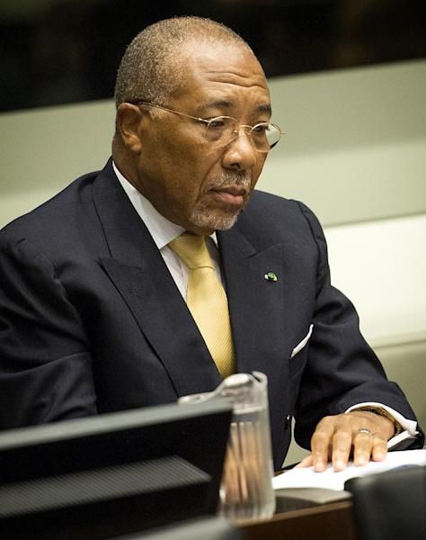 Former Liberian President Charles Taylor waits for the start of his appeal judgement at the Special Court for Sierra Leone (SCSL) in Leidschendam, near The Hague, Netherlands, Thursday Sept. 26, 2013. Judges at a U.N.-backed tribunual are delivering their judgment in Taylor's appeal against his convictions and 50-year sentence for planning and aiding atrocities by rebels in Sierra Leone's bloody civil war. Taylor, 65, became the first former head of state convicted by an international war crimes court since World War II when the SCSL found him guilty on April 26, 2012, of 11 counts of war crimes and crimes against humanity including terrorism, murder, rape and using child soldiers. (AP Photo/Koen van Weel, Pool)