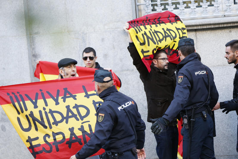The Latest: Top Catalan lawmaker to spend night in custody