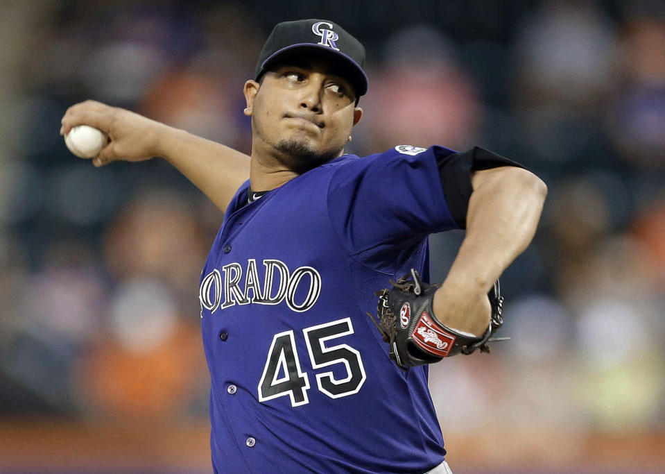 Colorado Rockies' Jhoulys Chacin delivers a pitch during the first inning of a baseball game against the New York Mets on Wednesday, Aug. 7, 2013, in New York. (AP Photo/Frank Franklin II)