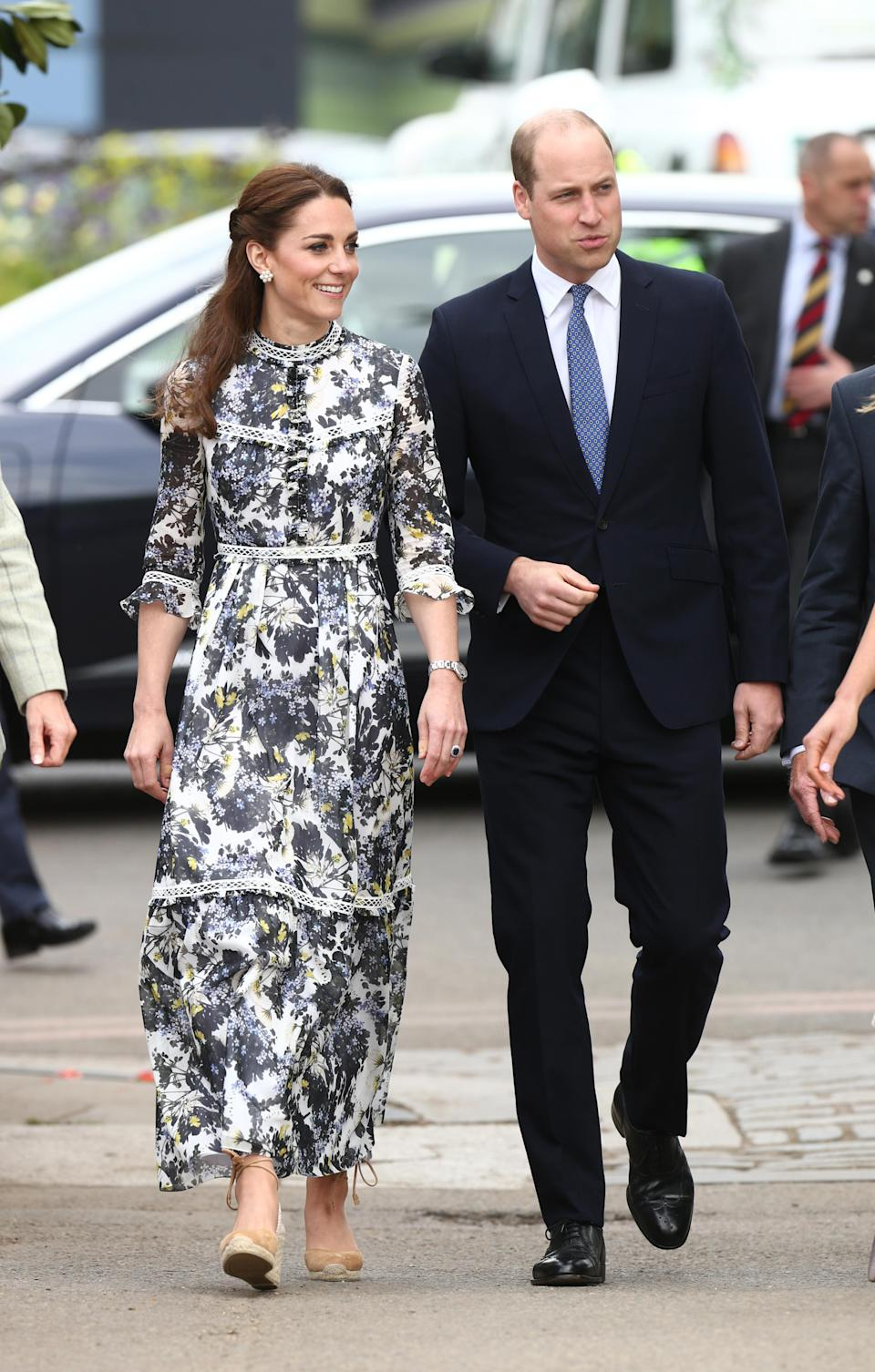 For the Chelsea Flower Show preview, the duchess donned a floral Erdem 'Shebah' maxi dress with her Castaner 'Carina' espadrille wedges and her Cassandra Goad pearl stud earrings. [Photo: PA]