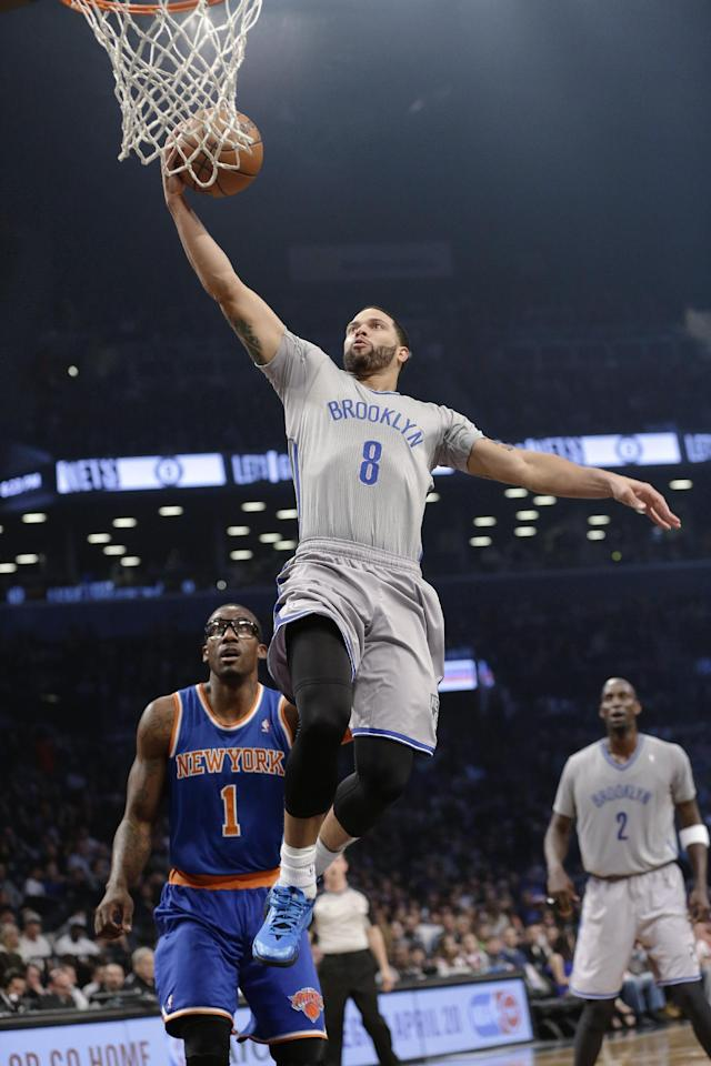 Brooklyn Nets' Deron Williams (8) drives past New York Knicks' Amare Stoudemire (1) during the first half of an NBA basketball game Tuesday, April 15, 2014, in New York. (AP Photo/Frank Franklin II)