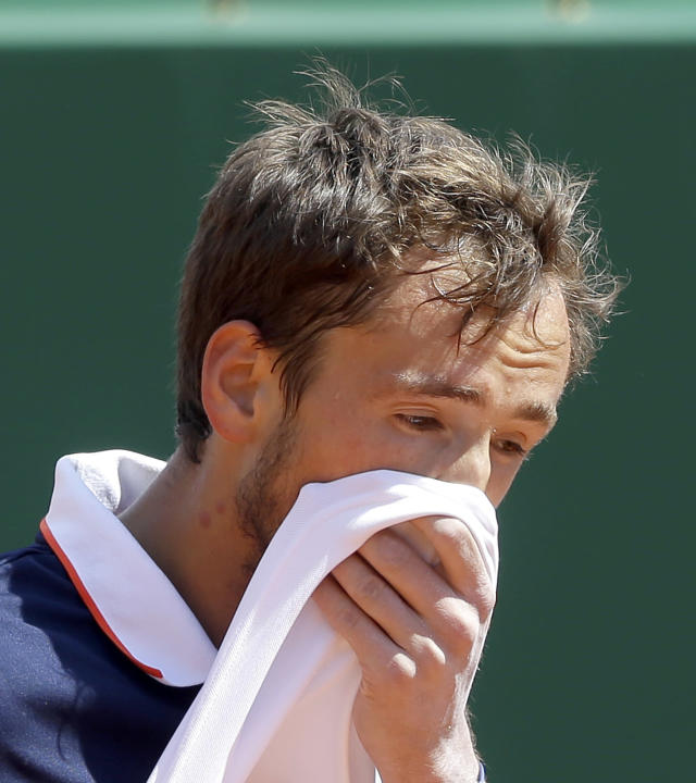 Russia's Daniil Medvedev wipes his face during their semifinal match against Serbia's Dusan Lajovic of the Monte Carlo Tennis Masters tournament in Monaco, Saturday, April 20, 2019. (AP Photo/Claude Paris)