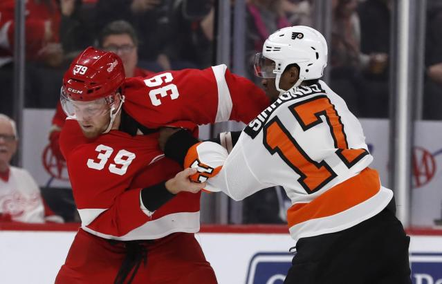 Detroit Red Wings right wing Anthony Mantha (39) and Philadelphia Flyers right wing Wayne Simmonds (17) fight during the first period of an NHL hockey game, Sunday, Feb. 17, 2019, in Detroit. (AP Photo/Carlos Osorio)