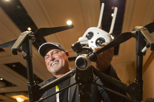 Randy Braun holds a DJI Inspire 1 flying platform during the 2015 International Consumer Electronics Show (CES) in Las Vegas, Nevada January 4, 2015. The remote control quadcopter, with 4K video camera and three-axis gimbal, is a sophisticated filmmaking system straight from the box, said Braun. The system retails for $2,890.00, he said. REUTERS/Steve Marcus (UNITED STATES - Tags: SCIENCE TECHNOLOGY BUSINESS)