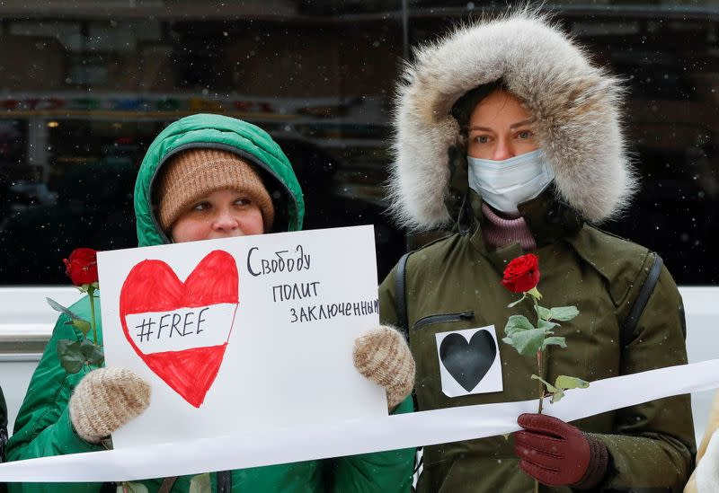 People attend a rally in support of Russian opposition politician Navalny, his allies and female political prisoners in Moscow