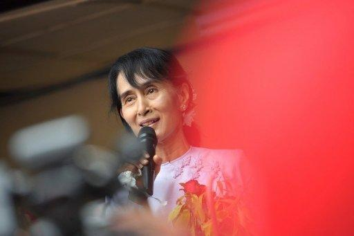Myanmar opposition leader Aung San Suu Kyi addresses journalists in Yangon on April 2. Suu Kyi's party won 43 of the 44 seats it contested in parliamentary elections, according to official results announced by state television