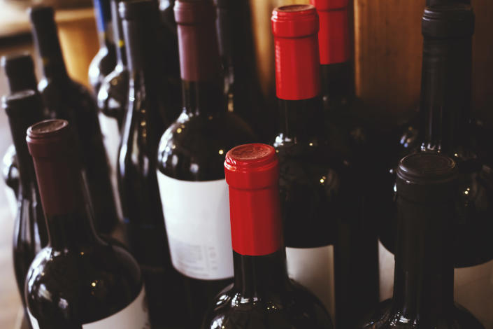 A view of several wine bottles in a restaurant or kitchen pantry. Photo: Getty