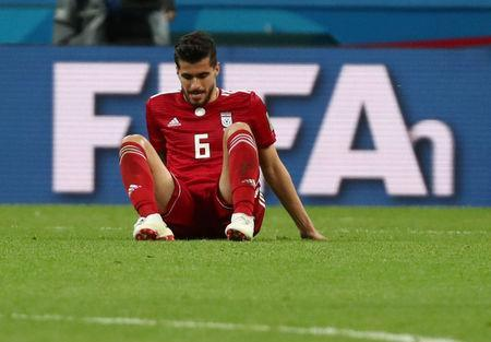 Soccer Football - World Cup - Group B - Iran vs Spain - Kazan Arena, Kazan, Russia - June 20, 2018 Iran's Saeid Ezatolahi looks dejected after the match REUTERS/Sergio Perez