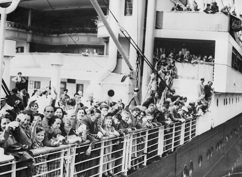 A crowd of Jewish refugees aboard the MS St. Louis ocean liner wave as they arrive in Antwerp, Belgium, after being denied refuge in North America.  (Bettmann via Getty Images)