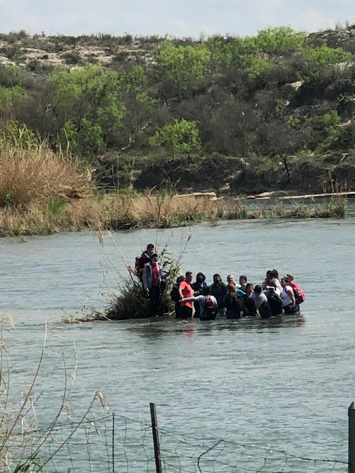 Immigrants migrating to Texas across the Rio Grande were rounded up in April 2021 by Deputy Val Verde County Sheriff.