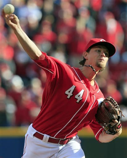 Cincinnati Reds starting pitcher Mike Leake throws against the San Francisco Giants in the first inning of Game 4 of the National League division baseball series, Wednesday, Oct. 10, 2012, in Cincinnati. (AP Photo/Al Behrman)