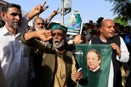 A supporter of former Prime Minister Nawaz Sharif reacts as he celebrate with others following the court's decision in Islamabad, Pakistan September 19, 2018.  REUTERS/Faisal Mahmood