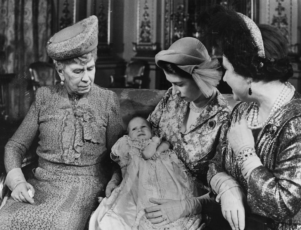 Four generations of the royal family gather: then-Princess Elizabeth holds Anne while sitting next to her mother, Queen Elizabeth (right), and her grandmother, Queen Mary.