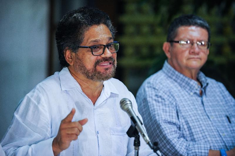 Commander Ivan Marquez (L) pictured in Havana, Cuba on November 19, 2015 is part of the FARC delegation that on November 26 called for UN oversight of safe zones if and after a peace deal with Colombia's  government is reached