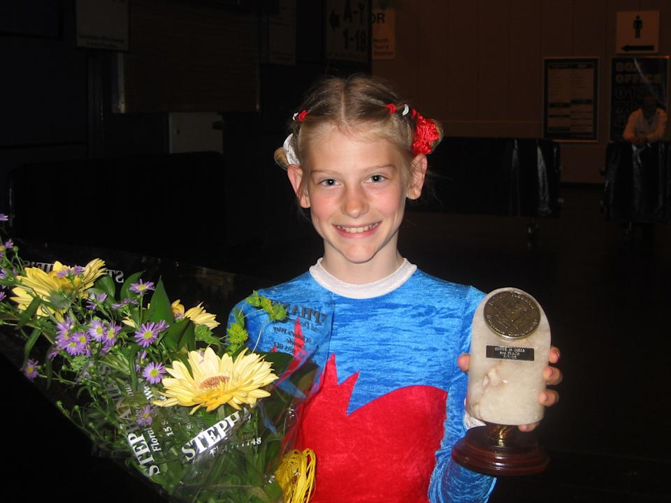 Bryony Page receives one of her first trampolining prizes in 2002