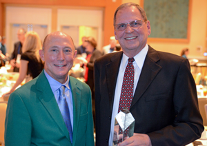 """Kit Dietz (right) at the 2017 Convenience Distribution Association Industry Awards event with CDA Chairman Rob Sincavich (left) after Dietz was named """"Dean of the Industry"""""""