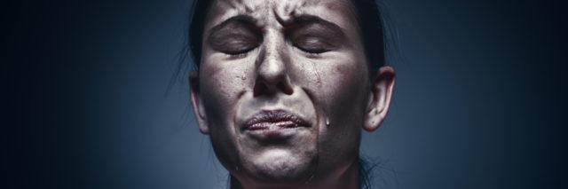 a close-up picture of woman crying