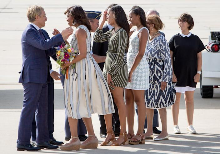 <p>First Lady Michelle Obama, her mother, Marian Shields Robinson, and her daughters Malia Obama and Sasha Obama arrive at Torrejon Air Force Base on June 29, 2016 in Madrid. (Pablo Cuadra/Getty Images) </p>