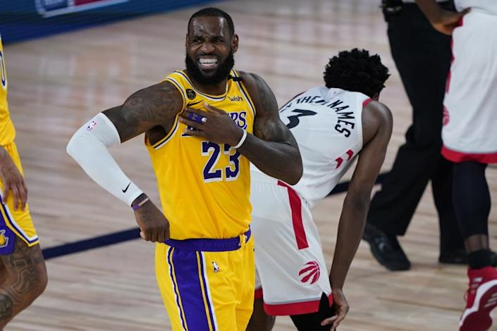 """The Lakers' LeBron James reacts after a play against the Raptors during the second half. He finished with 20 points. <span class=""""copyright"""">(Ashley Landis / Associated Press)</span>"""